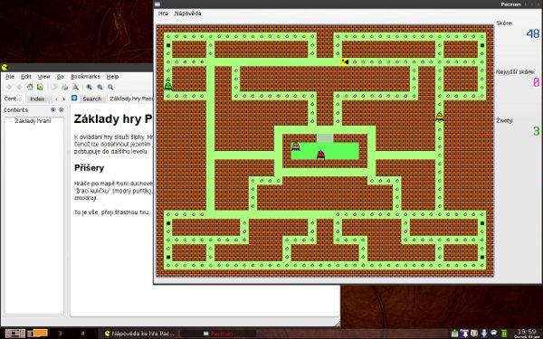 První level Pacmana se spuštěnou nápovědou na pozadí